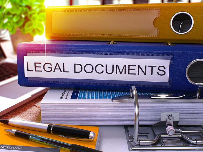 Blue Office Folder with Inscription Legal Documents on Office Desktop with Office Supplies and Modern Laptop. Legal Documents Business Concept on Blurred Background. Legal Documents - Toned Image. 3D..jpeg