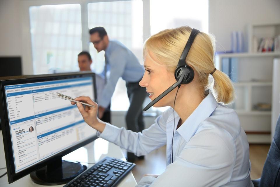 Customer service operator talking on the phone.jpeg