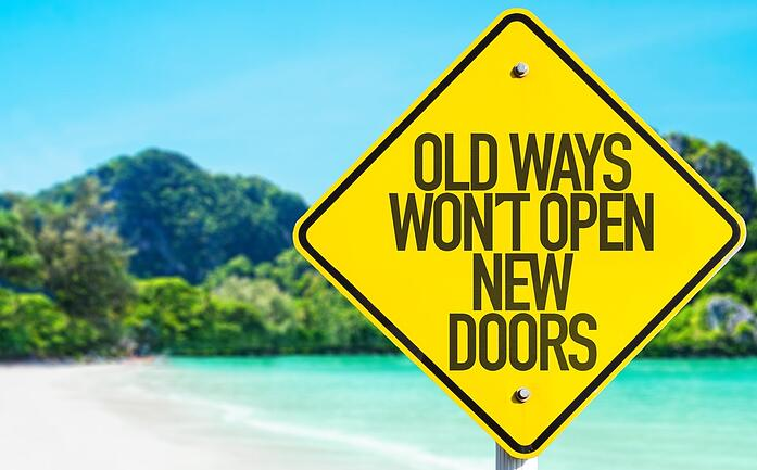 Old Ways Wont Open New Doors sign with beach background.jpeg