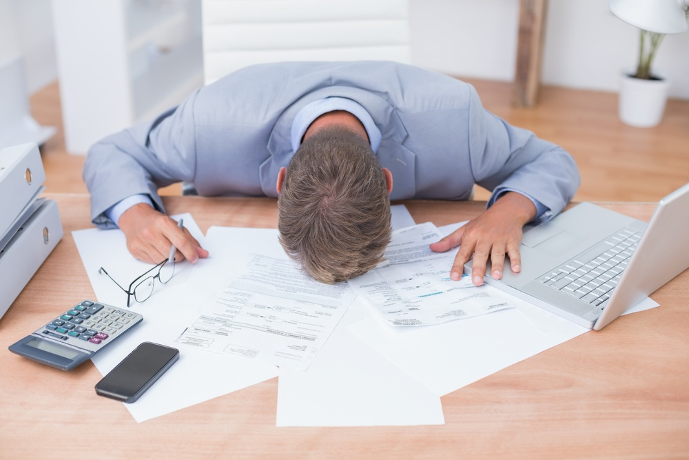 Businessman being depressed by accounting in his office.jpeg