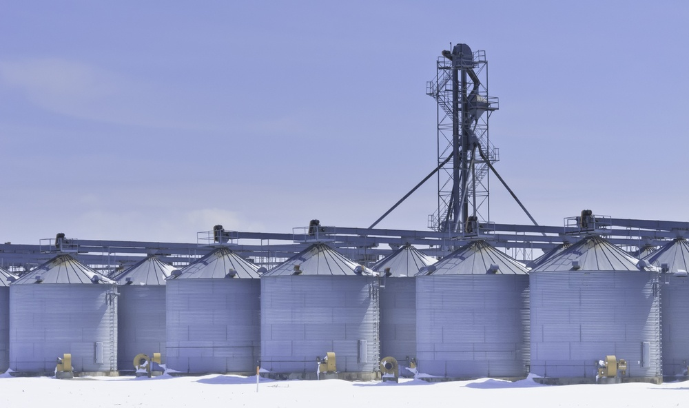 Steel grain silos and control tower above snow in March, central Illinois.jpeg